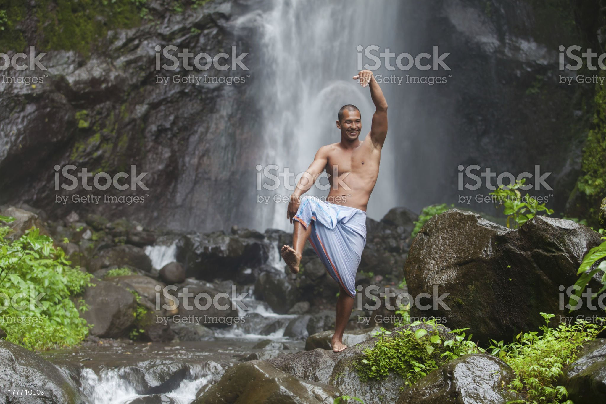 Handsome man at waterfall royalty-free stock photo