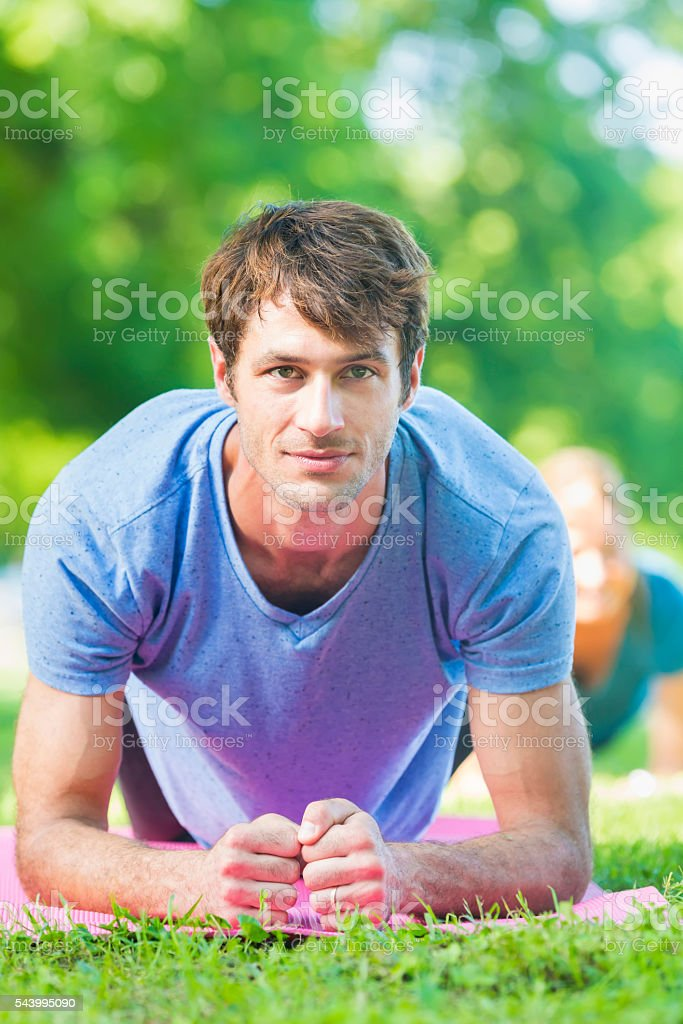 Handsome man deep in focus while working out stock photo