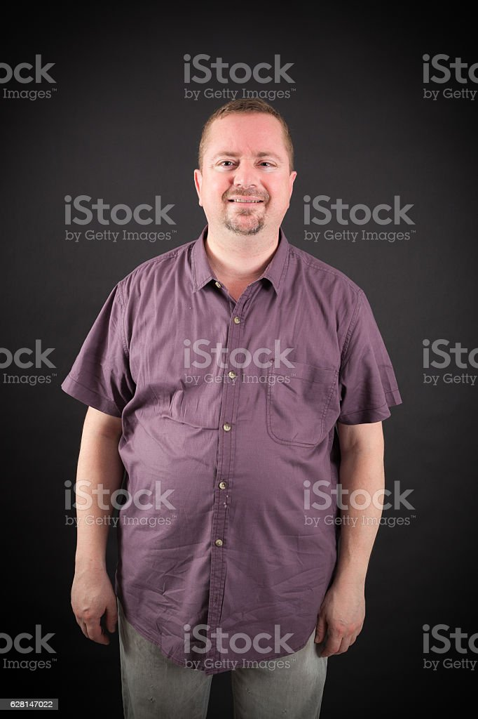 Handsome man doing different expressions in different sets of clothes: smile stock photo
