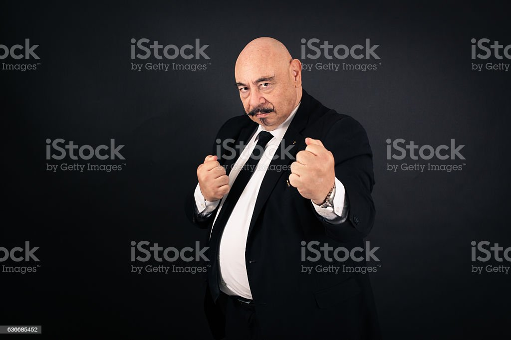 Handsome man doing different expressions in different sets of clothes: boxe stock photo