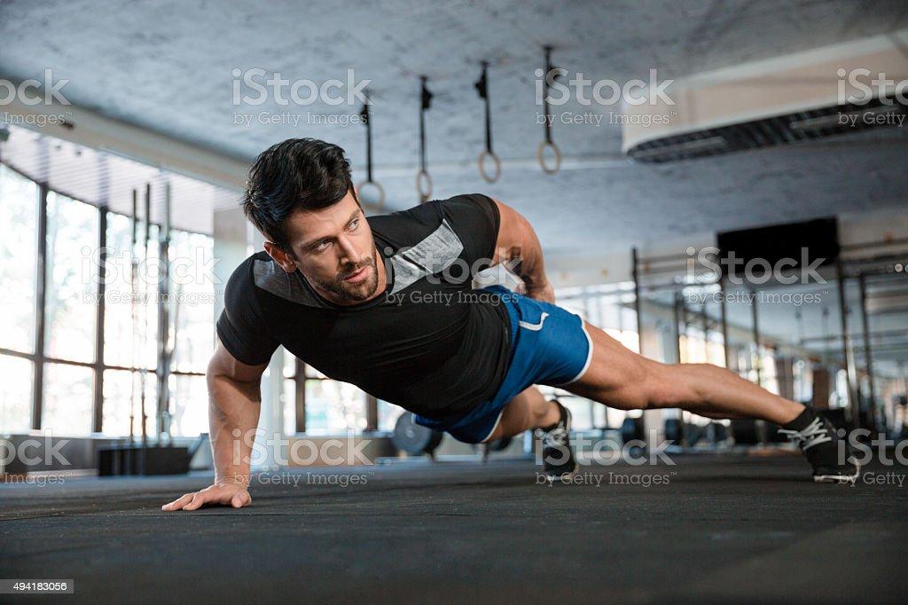 Handsome man doing push ups exercise stock photo