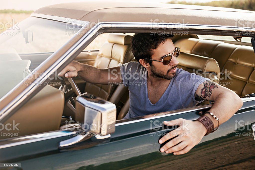 Handsome man driving car stock photo