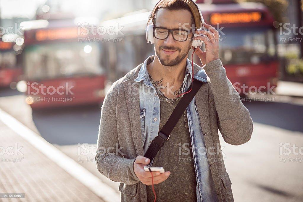 handsome man enjoying and listening to music stock photo