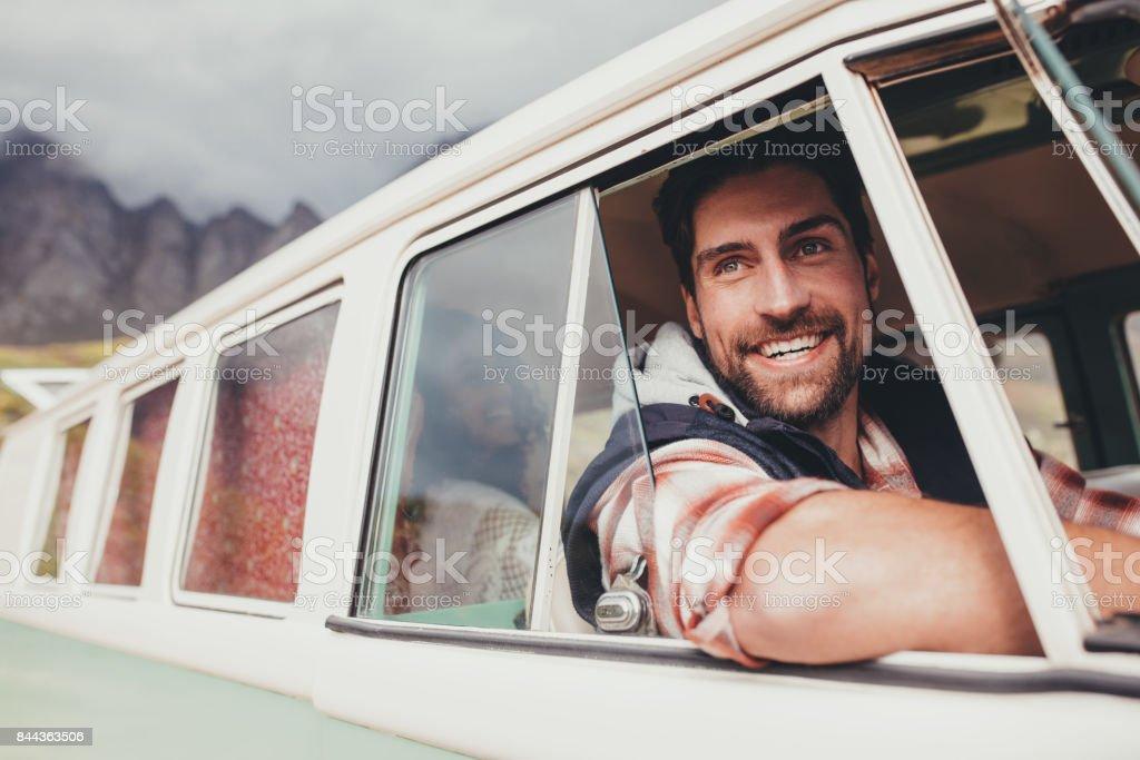Handsome man enjoying his road trip stock photo