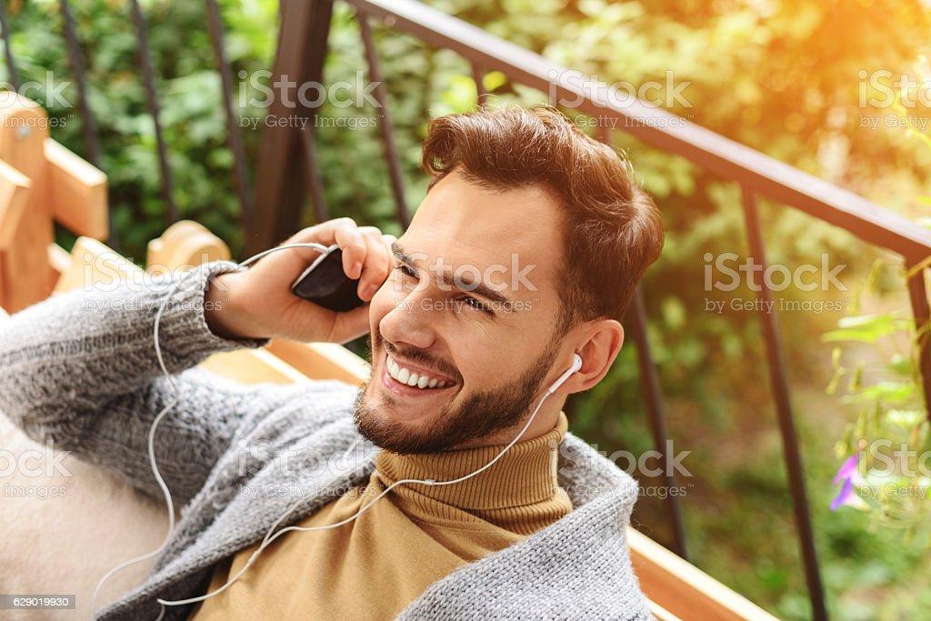 handsome man enjoying music stock photo