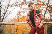 Handsome man enjoys fall