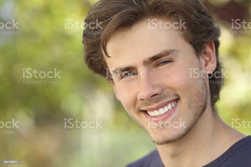 Handsome man face with a white perfect smile stock photo