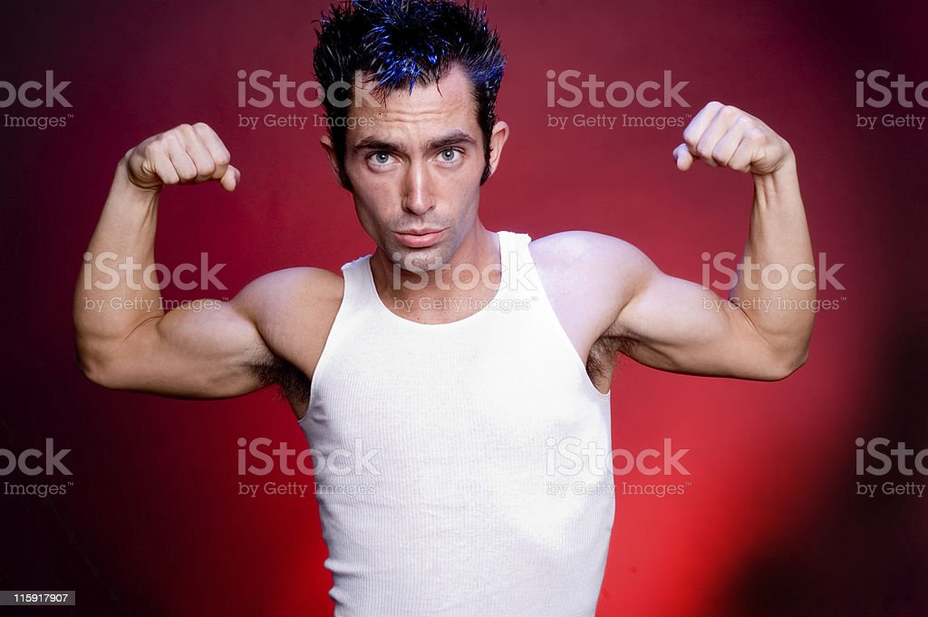 Handsome man Flexing his muscles royalty-free stock photo