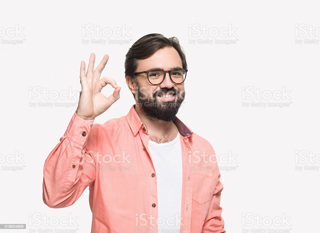 Handsome man gesturing the Okay Sign stock photo