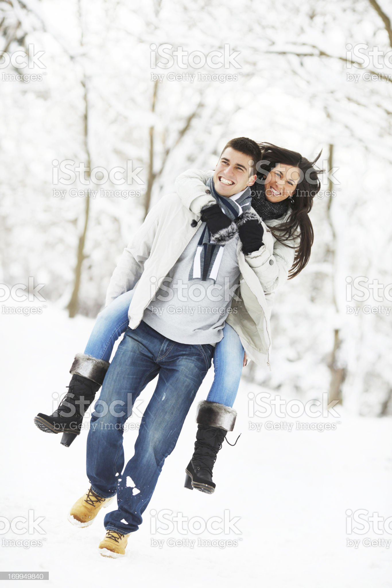 Handsome man giving his girlfriend a piggyback ride. royalty-free stock photo