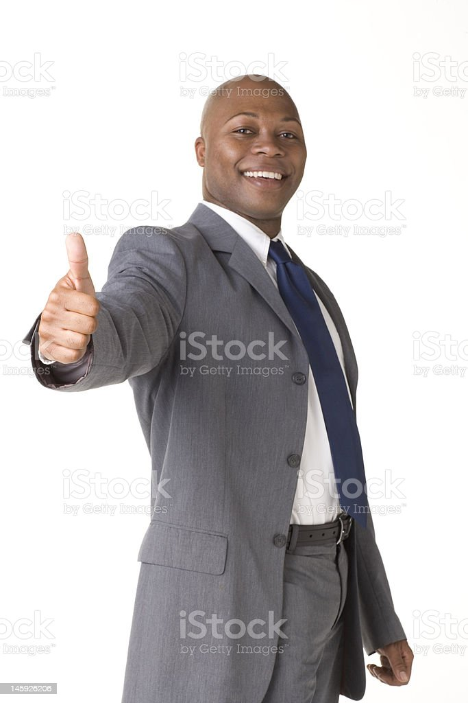 Handsome man giving the thumbs up sign royalty-free stock photo