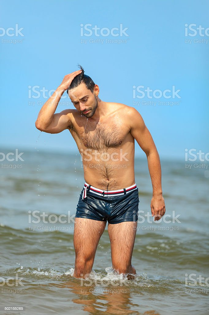 Handsome Man Going Out Of Sea royalty-free stock photo