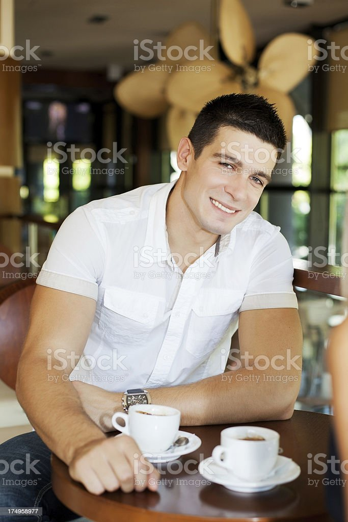Handsome man having coffee in cafe. royalty-free stock photo
