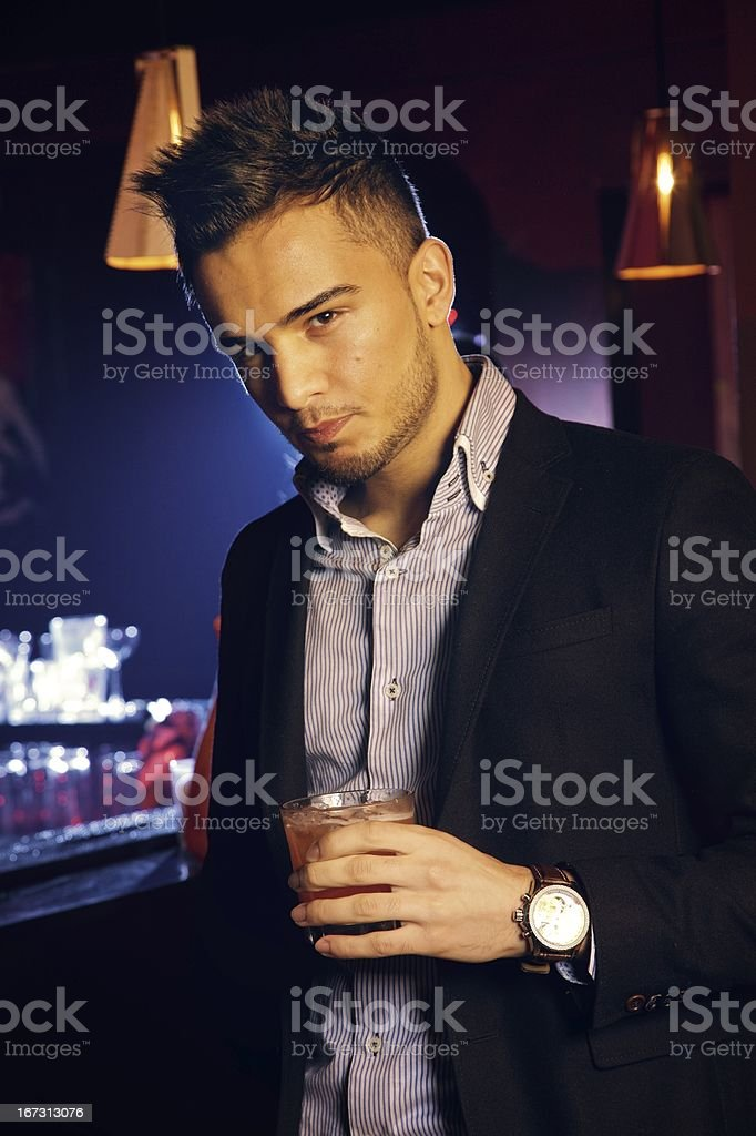 Handsome Man Holding a Glass of Whiskey royalty-free stock photo