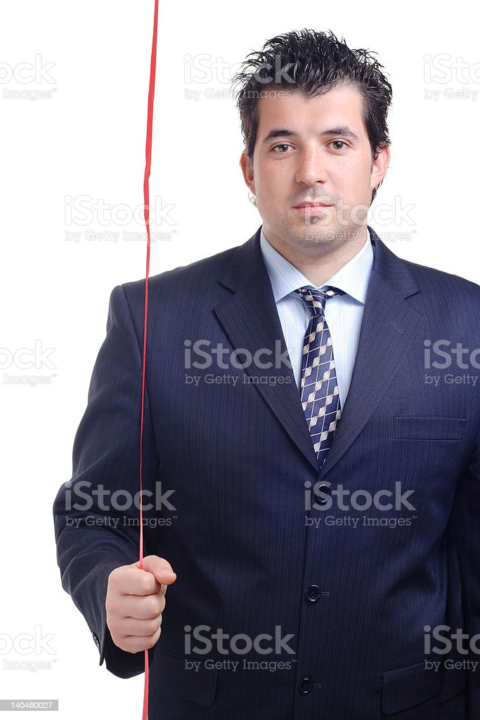 Handsome man holding a red tape stock photo