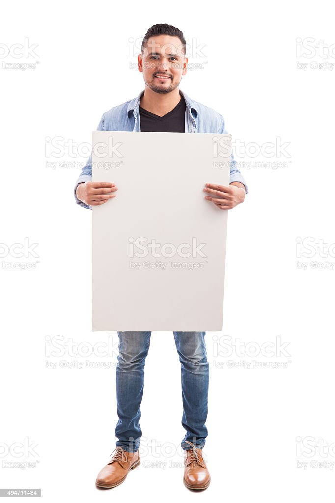 Handsome man holding a sign stock photo