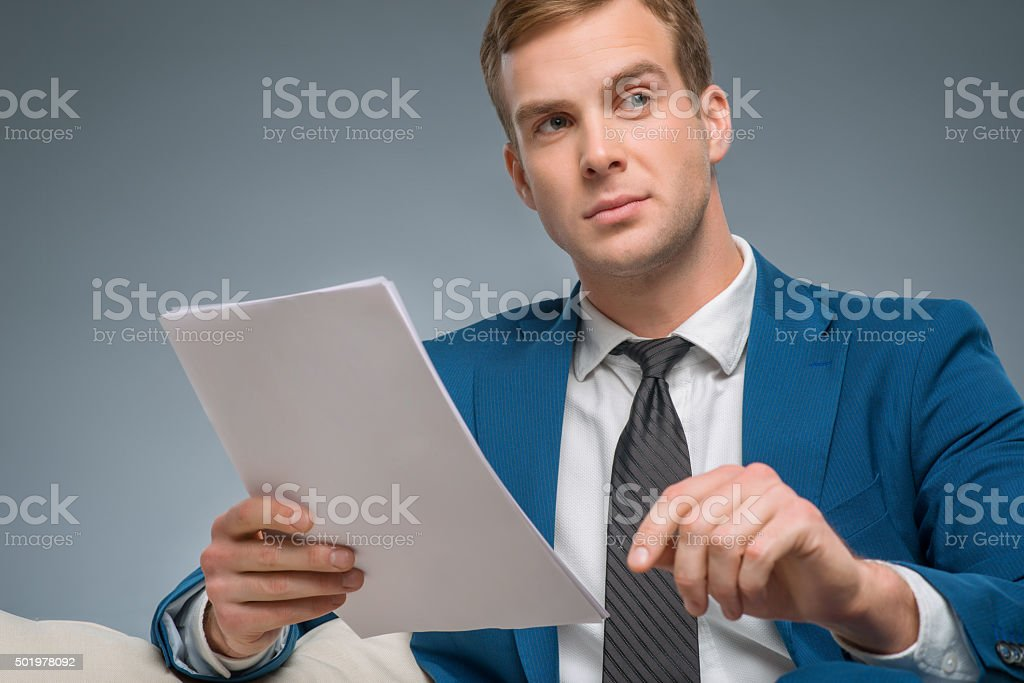 Handsome man holding papers stock photo