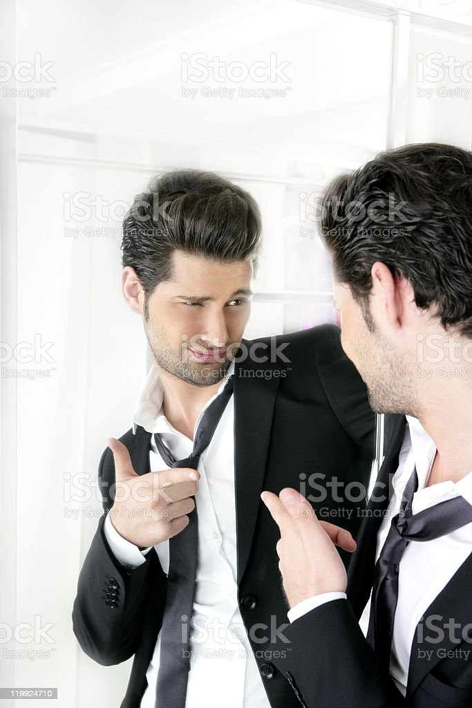 Handsome man humor funny gesture in a mirror royalty-free stock photo
