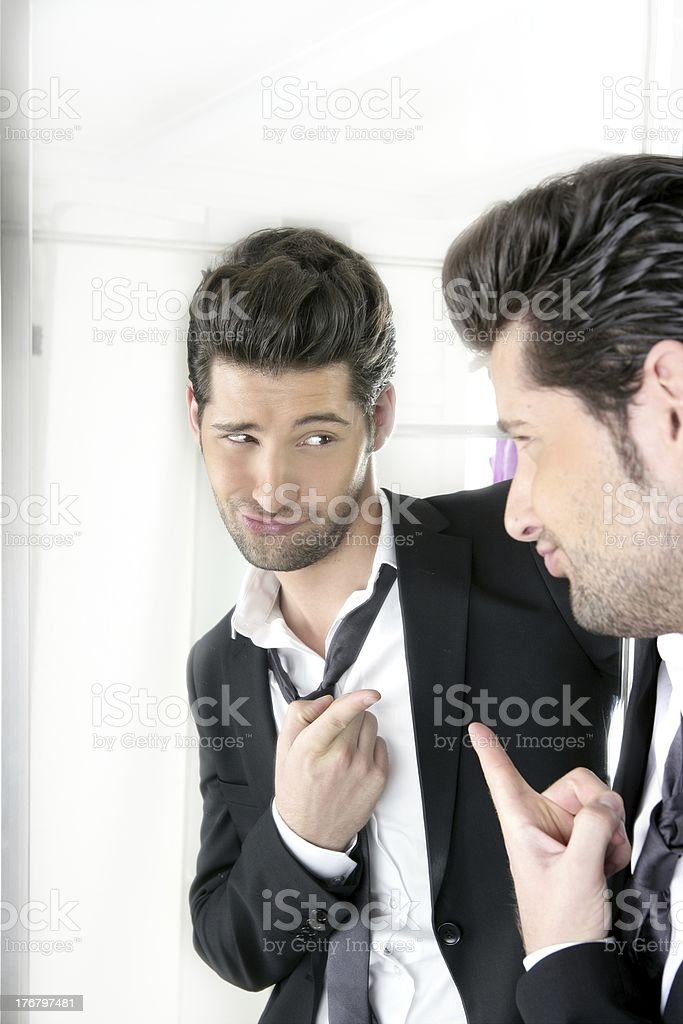 Handsome man humor funny gesture in a mirror stock photo