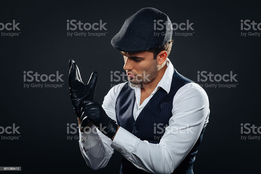Handsome man in a vest and cap stock photo
