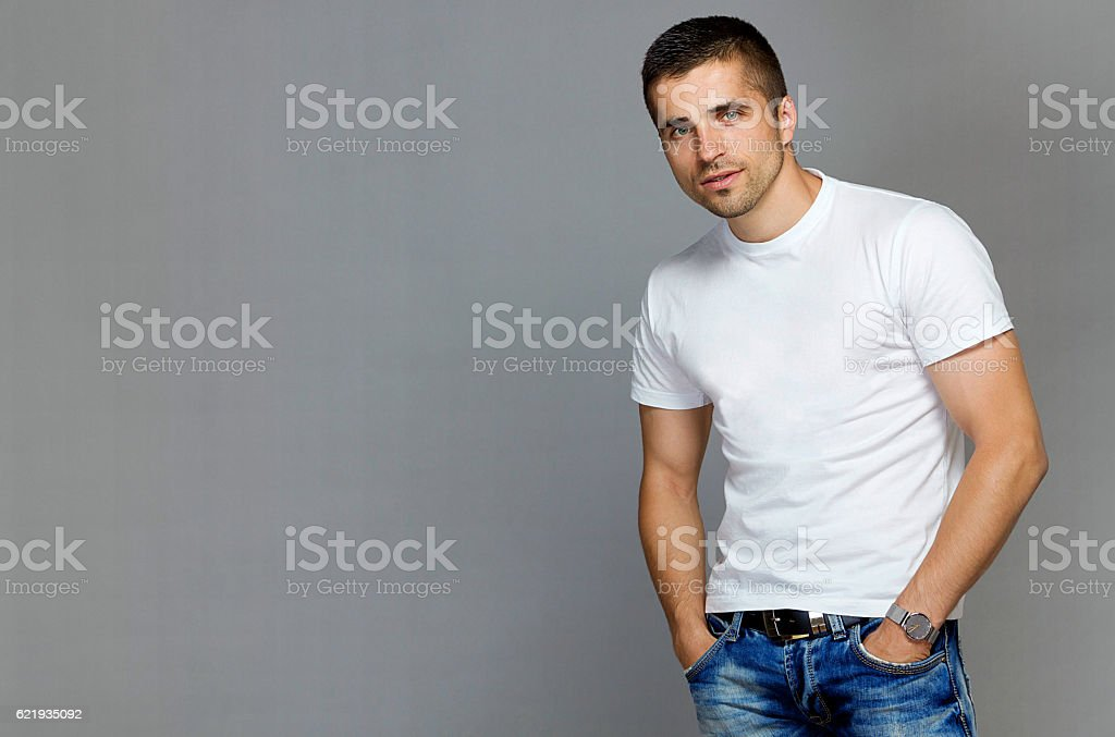 handsome man in a white T-shirt and jeans stock photo