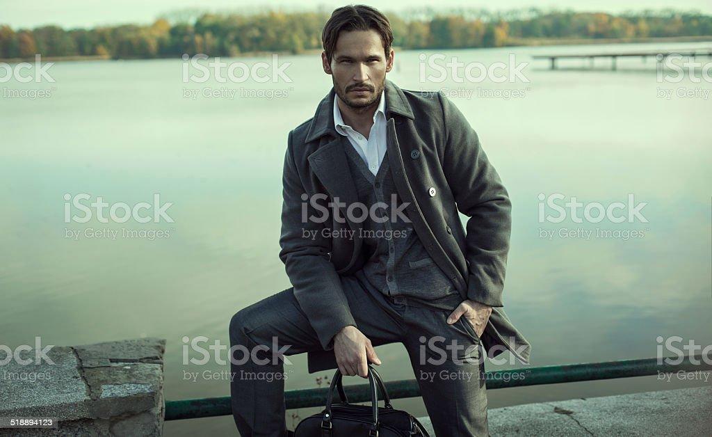 Handsome man in autumn scenery stock photo