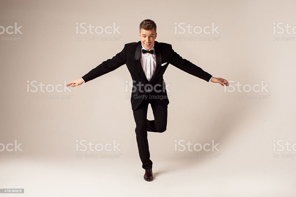Handsome man in black tuxedo stock photo
