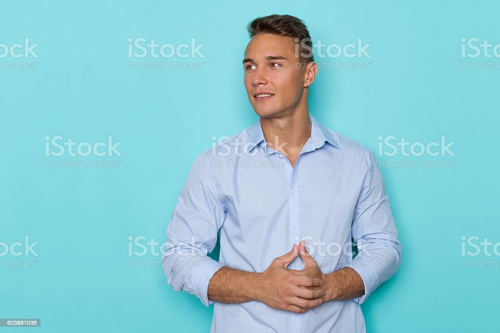 Handsome Man In Blue Shirt Looking Away stock photo
