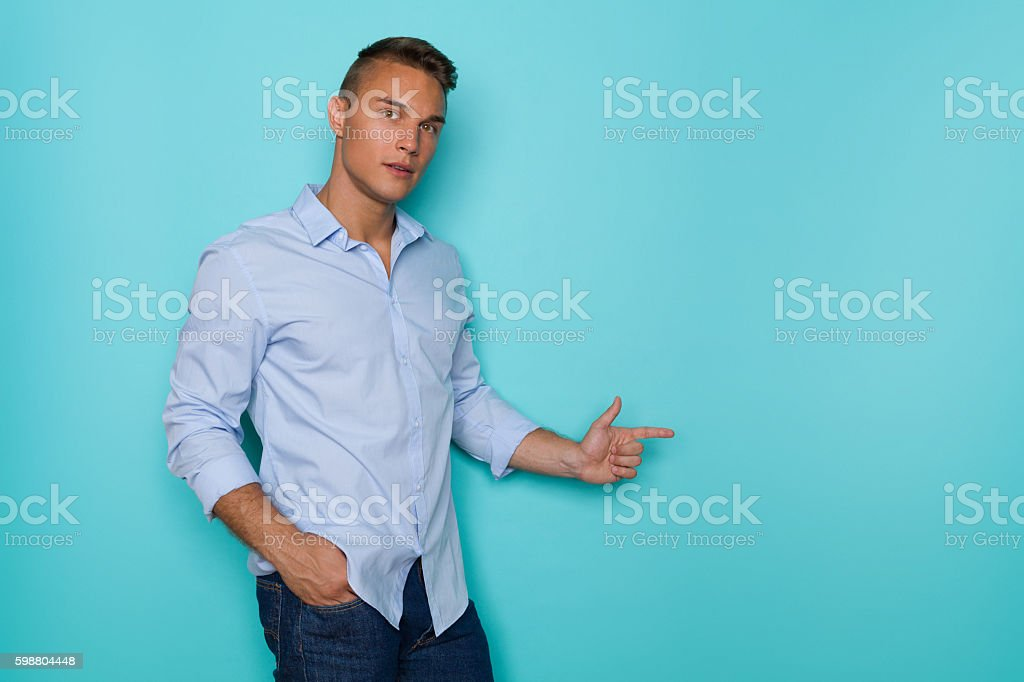 Handsome Man In Blue Shirt Notice stock photo