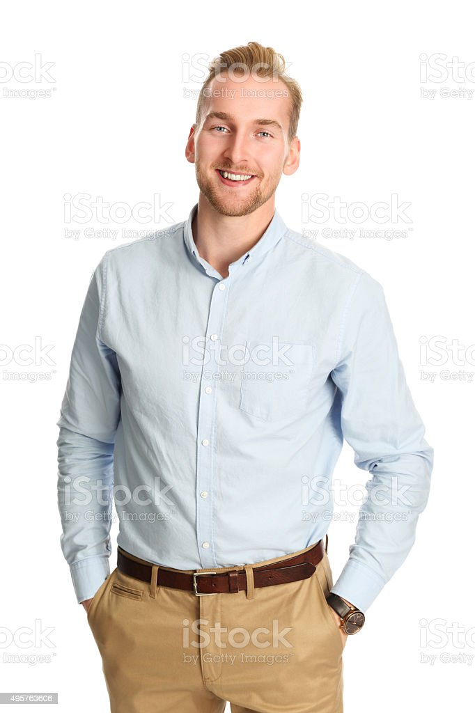 Handsome man in blue shirt smiling stock photo