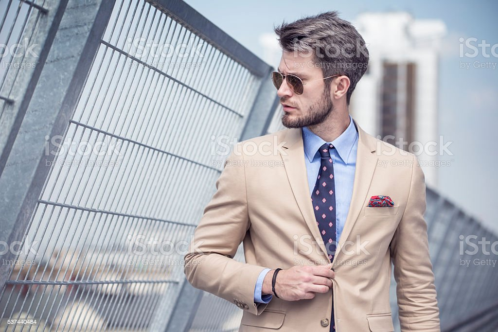 Handsome man in bright suit stock photo