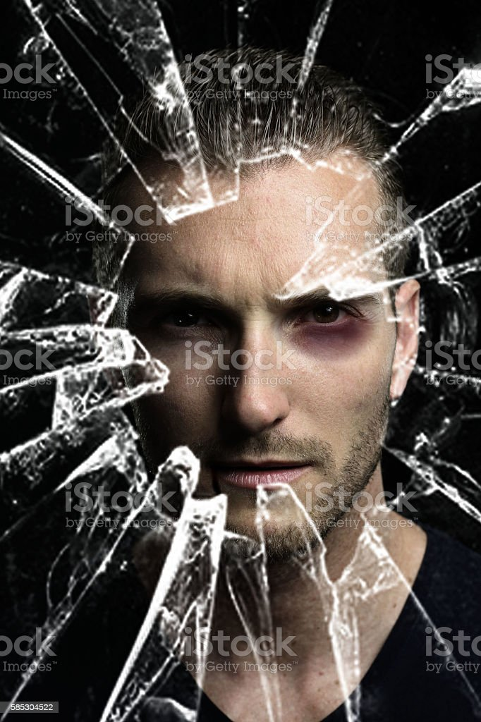 handsome man in front of a broken mirror stock photo