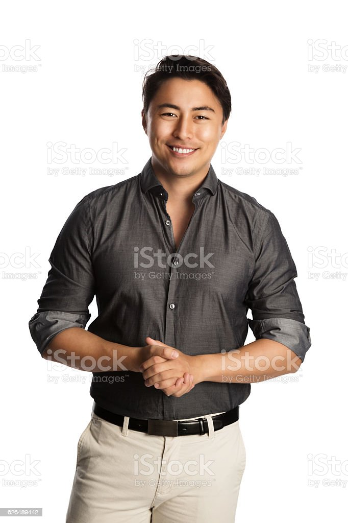 Handsome man in grey shirt stock photo