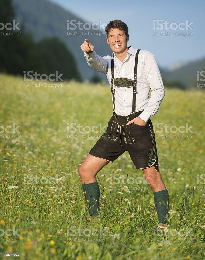 Handsome Man in Lederhosen Pointing (XXXL) royalty-free stock photo