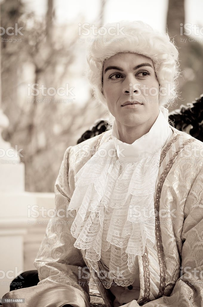 Handsome Man in Old French Costumes stock photo