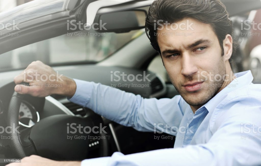 handsome man in the car royalty-free stock photo
