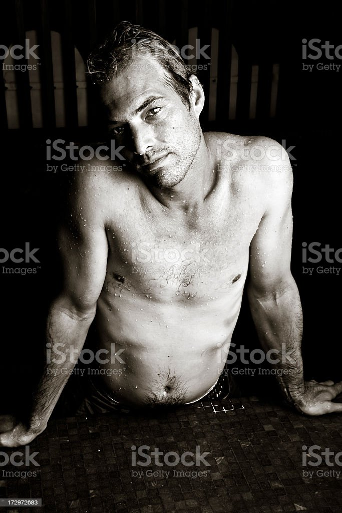 Handsome man in the pool royalty-free stock photo