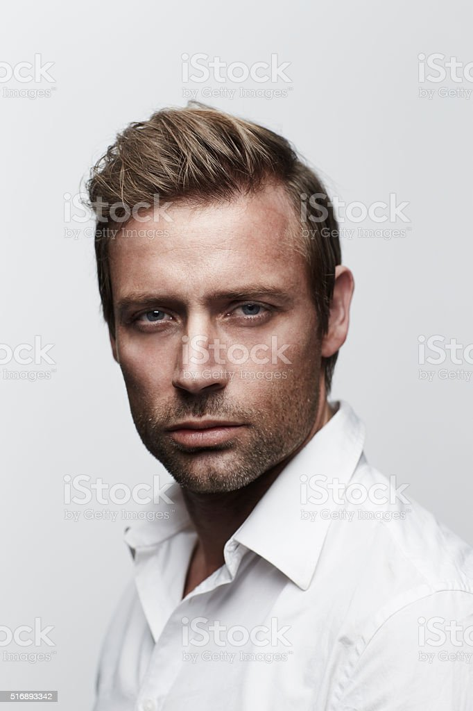 Handsome man in white shirt, portrait stock photo