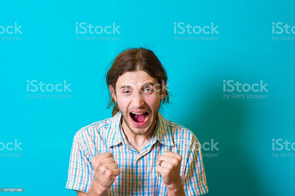 handsome man is pleased with his fists stock photo