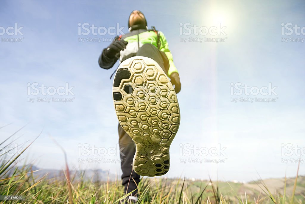 Handsome man is walking in the countryside stock photo