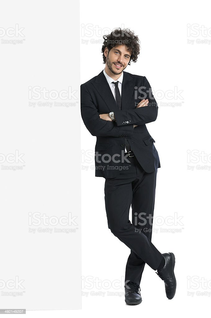 Handsome Man Leaning On Billboard stock photo