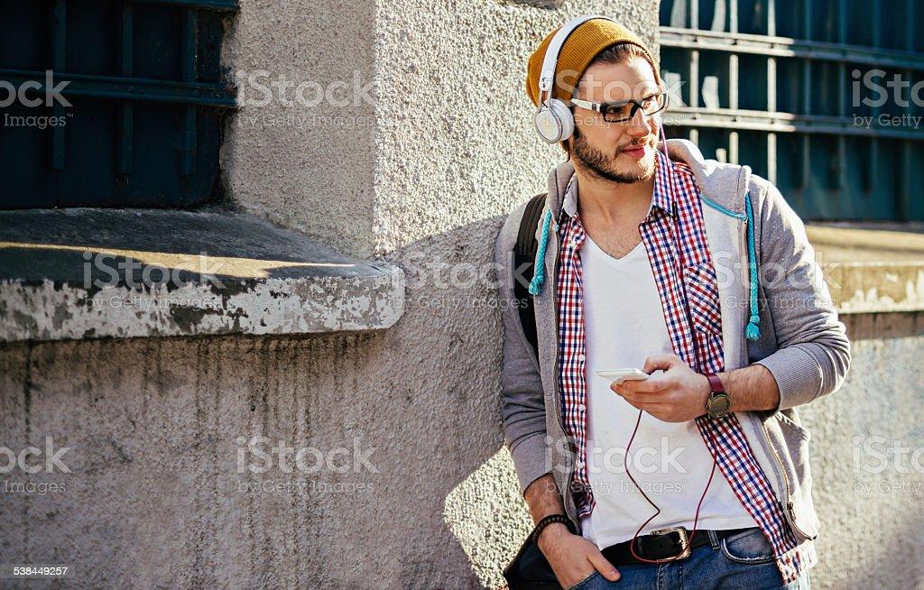handsome man listening to music stock photo