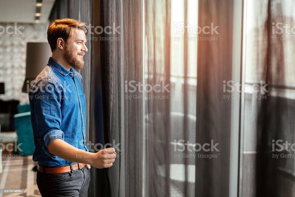 Handsome man looking at cityscape stock photo
