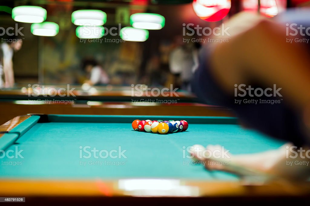 Handsome man looking to break the balls in snooker stock photo
