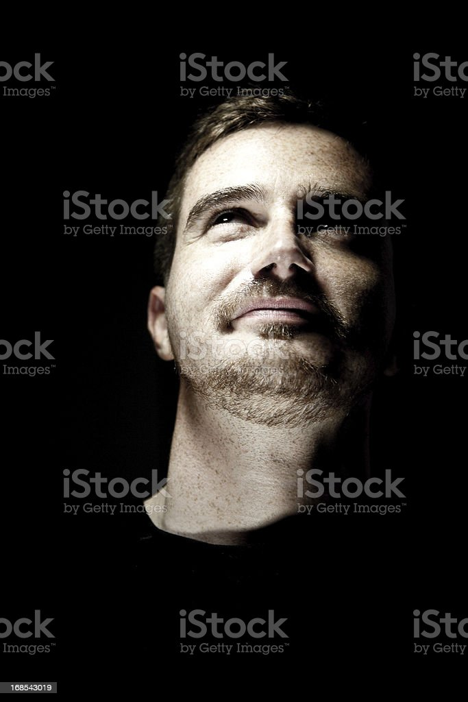 Handsome Man Looking Up stock photo