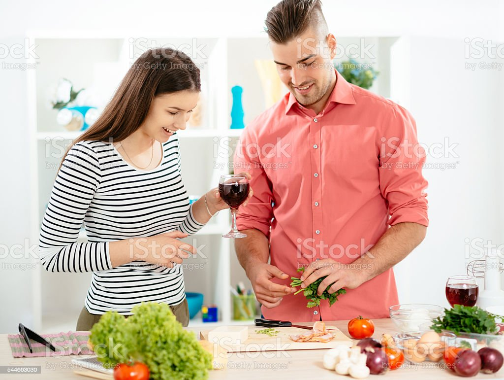 Handsome man making dinner and his wife is so excited stock photo