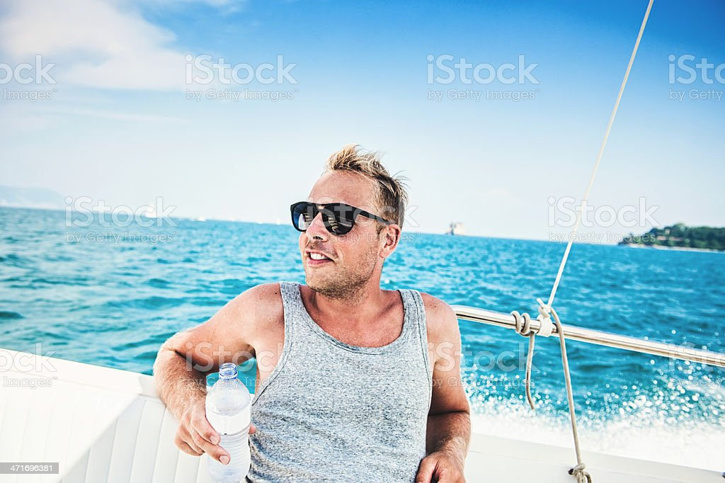 Handsome man on a boat in Italy stock photo
