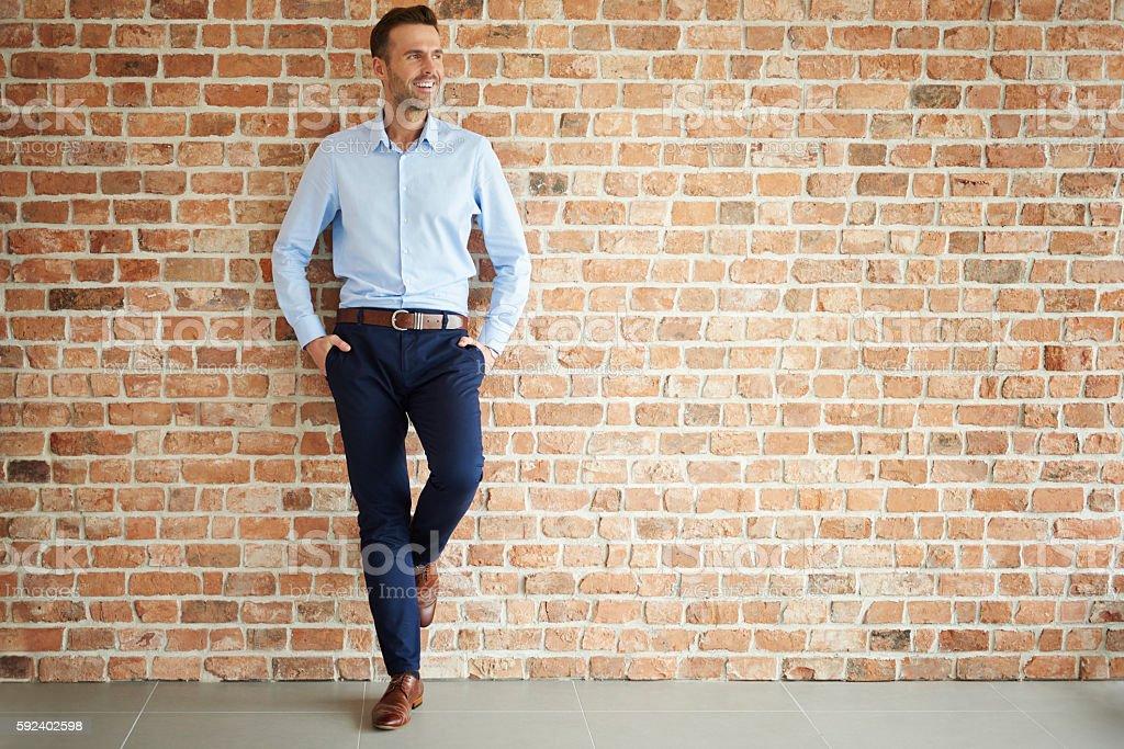 Handsome man on brick wall stock photo