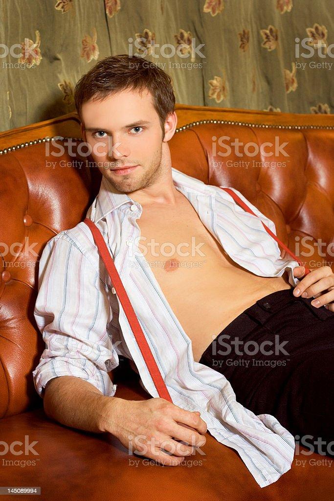 Handsome man on sofa royalty-free stock photo