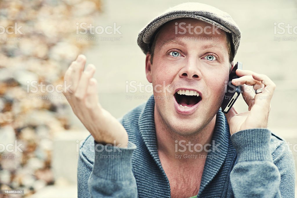 Handsome man outdoors talking on the phone stock photo
